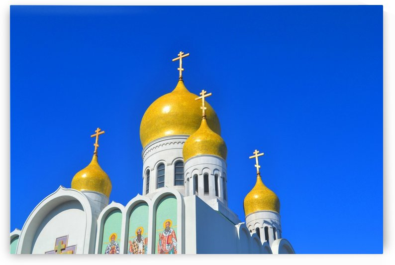 Yellow roofs of a church by Elena Ska