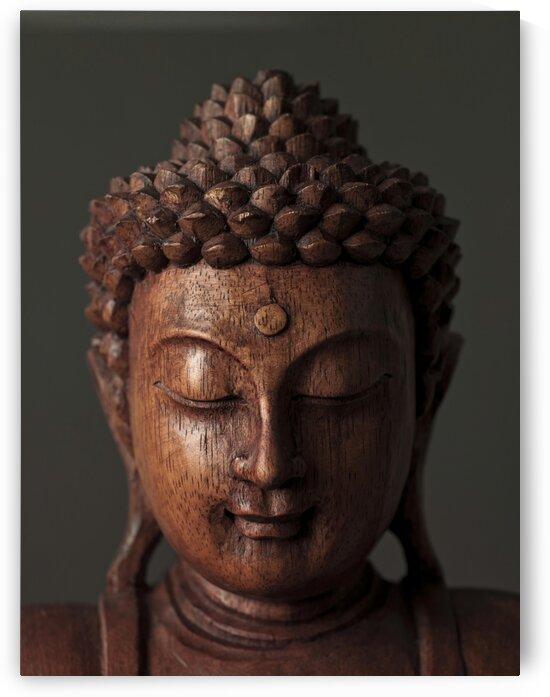 Buddha sculpture face by Assaf Frank