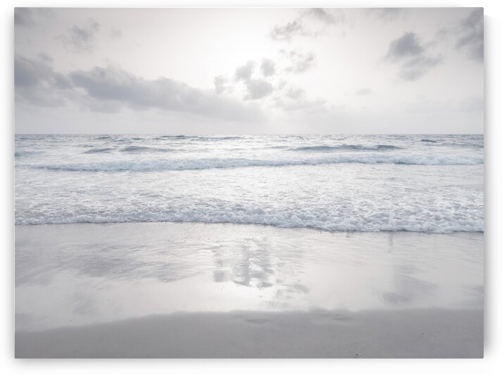 Tranquil beach with cloudscapes by Assaf Frank
