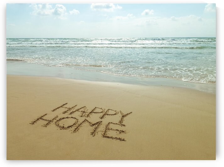 Happy Home written in sand on the beach by Assaf Frank