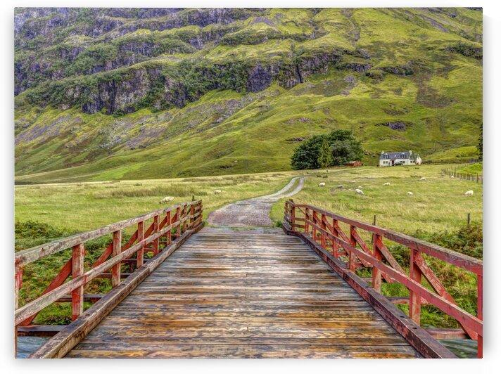 Wooden bridge over water stream at Glen Coe valley, Scotland by Assaf Frank