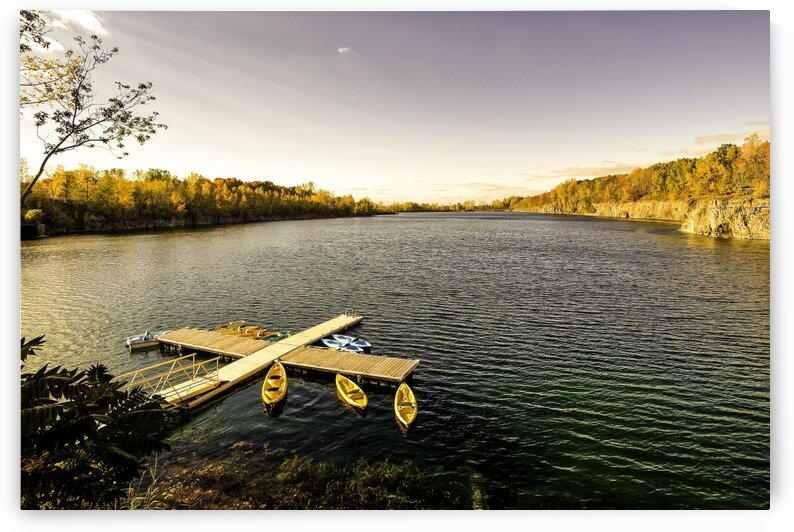 Lake and canoes at sunset by Daniel Ouellette