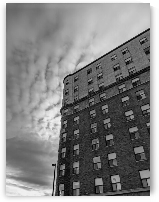 Black and white low angle view of side of building by Michael Geyer