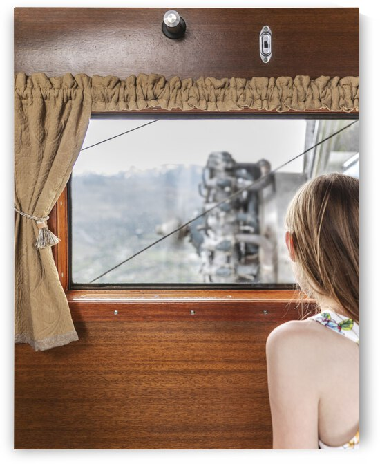 Girl Looking Out An Airplane Window by Evan Petty Photography