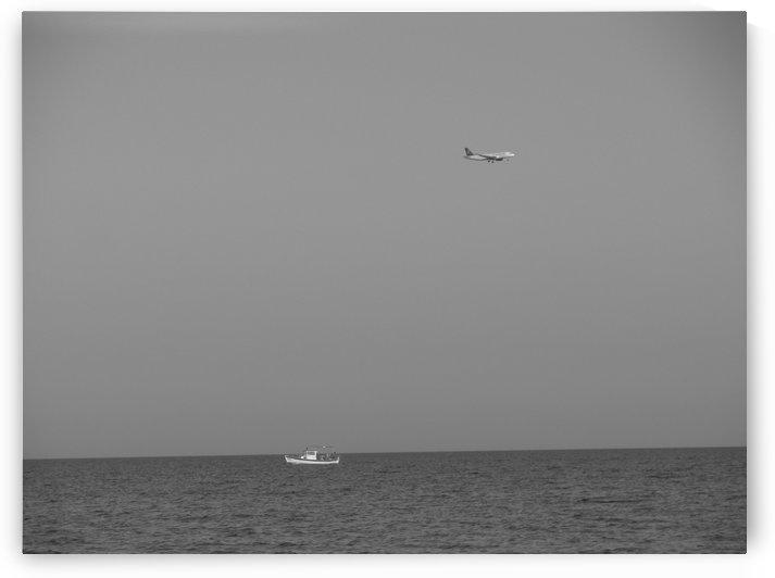 Traveling vehicles near the coast of Larnaca, Cyprus by Vlad Radulian