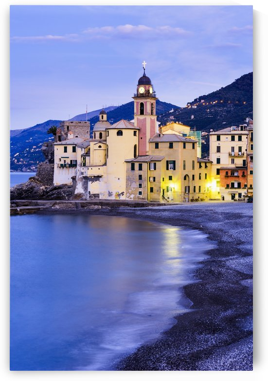 Buildings illuminated by lights along the water's edge at sunrise; Camogli, Liguria, Italy by PacificStock