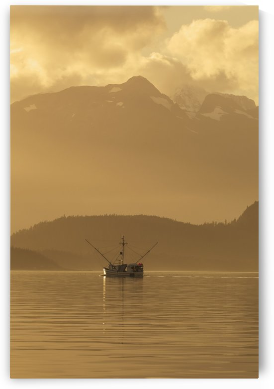 A commercial fishing vessel long line heads south in Lynn Canal near Juneau, Alaska, Chilkat Mountains beyond. by PacificStock