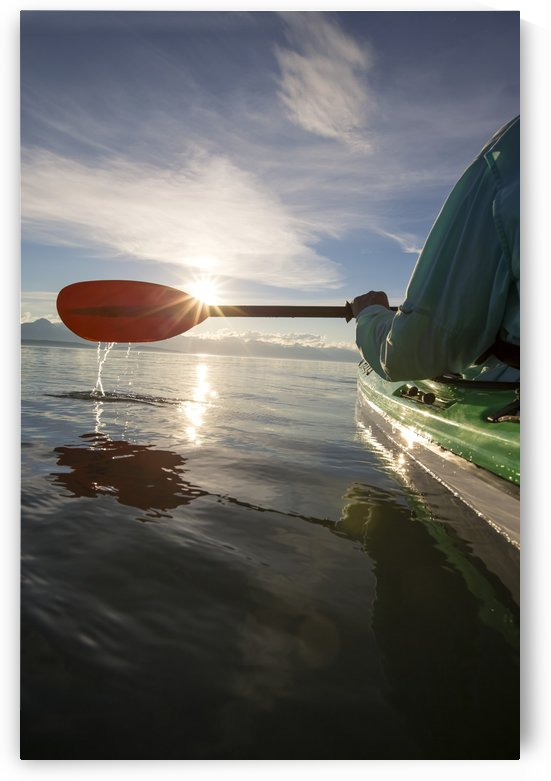 Evening sea kayaking in Lynn Canal near Eagle Beach State Recreation Area, Juneau, Alaska, Chilkat Mountains beyond in the distance. by PacificStock