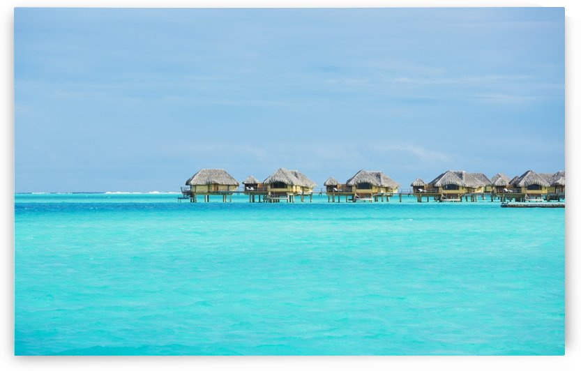 Over-water bungalows at a tropical resort; Bora Bora, French Polynesia by PacificStock