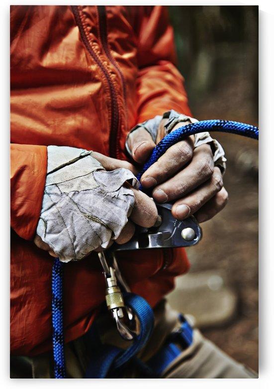 Man adjusting rock climbing equipment in the Adirondacks; New York, USA by PacificStock