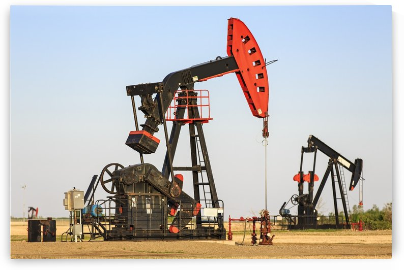Oil well pump jacks at Bakken Oil Field near Estevan; Saskatchewan, Canada by PacificStock