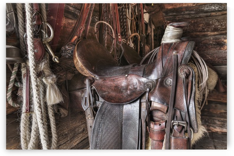 Saddle and horseback riding equipment at Bar U Ranch National Historic Site; Longview, Alberta, Canada by PacificStock
