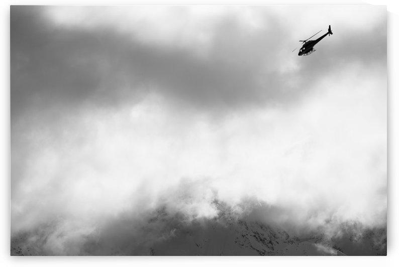 Heli ski helicopter flying amongst fog and clouds, New Zealand by PacificStock