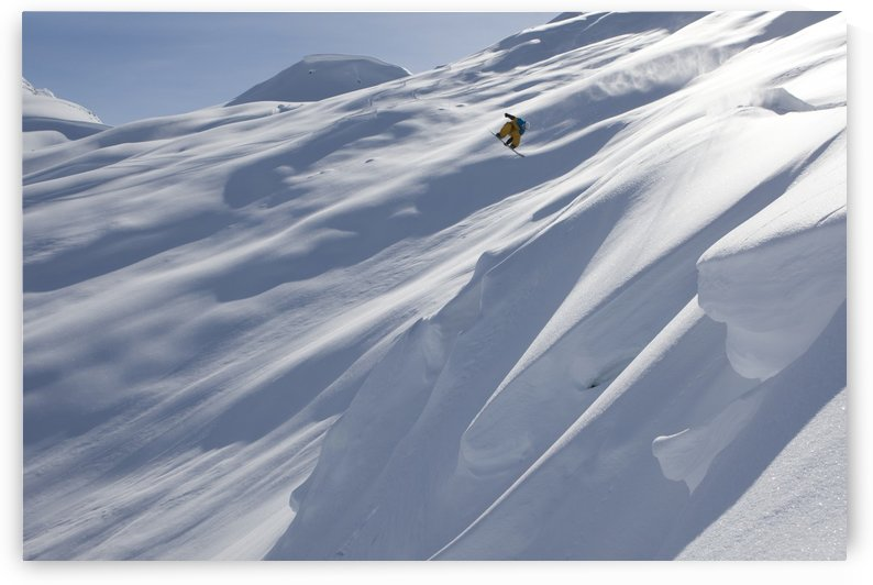 Professional snowboarder, Frederik Kalbermatten, heli boarding in the mountains above Haines, Southeast Alaska by PacificStock