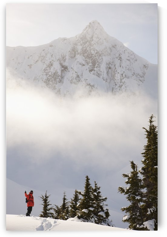 Snowboarder on a ridge with scenic mountains and fog in the background, Haines, Southeast Alaska by PacificStock