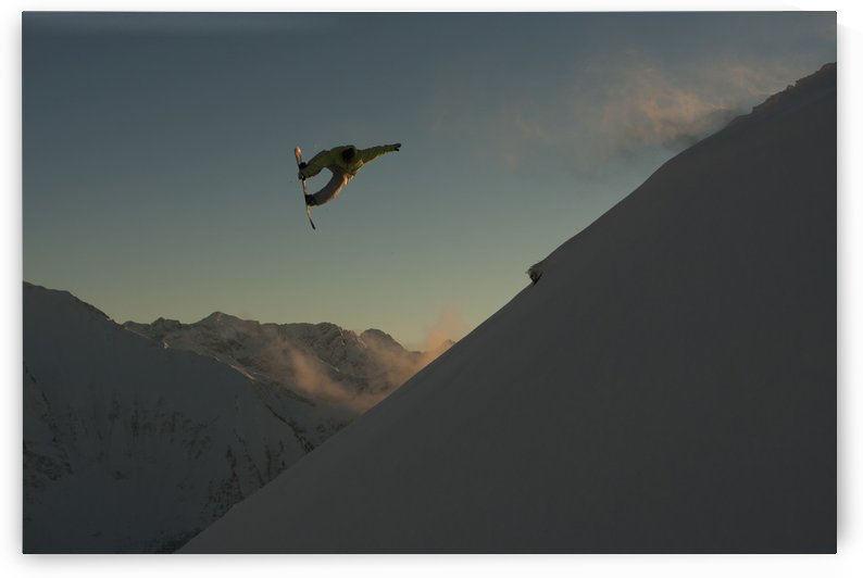 Professional snowboarder, Frederik Kalbermatten, extreme snowboarding at sunset, Arlberg, Austria by PacificStock