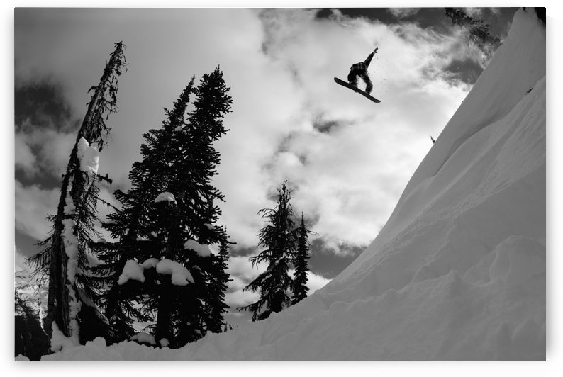 Professional snowboarder, Kevin Pearce, makes a big air jump, Canada by PacificStock