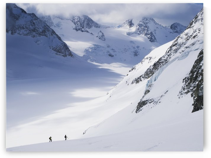 Two skiers in big glacial landscape, descending the eastern flank of the Pigne d'Arolla towards d'Ottemma glacier; Switzerland by PacificStock