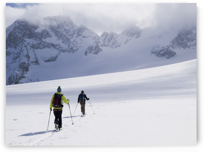 Two skiers ski touring across the Ottemma glacier; Switzerland by PacificStock