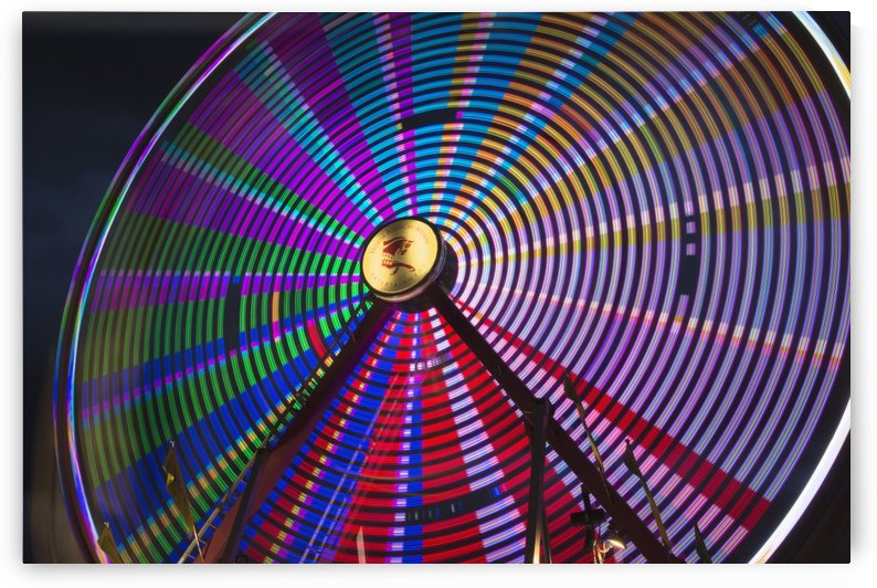 Light effect of a fairground ride at night at the Calgary Stampede; Calgary, Alberta, Canada by PacificStock