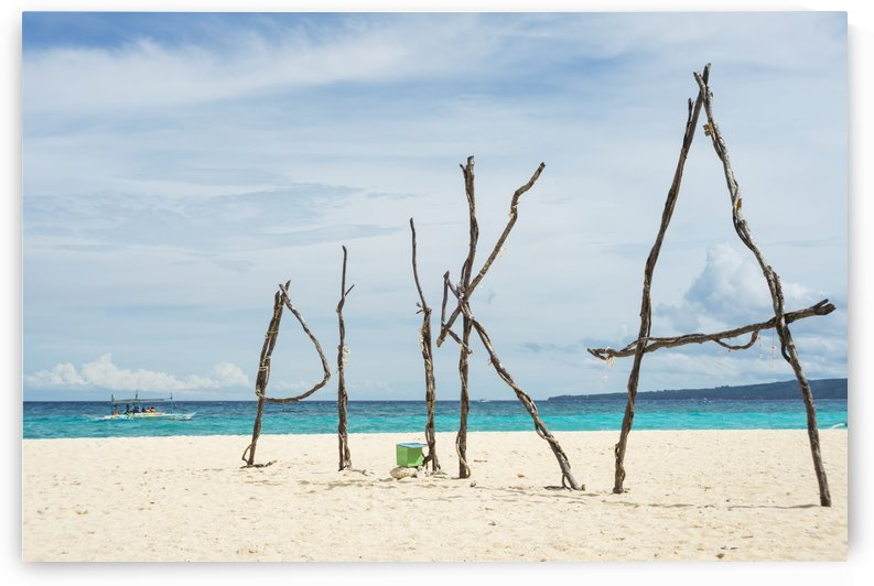 Puka beach in Boracay, white sand and blue water, with the work puka made of tree branches; Boracay, Panay, Philippines by PacificStock