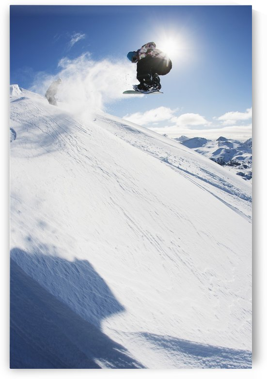 Professional snowboarder making a jump in fresh snow near Ushuaia, Patagonia, Argentina by PacificStock