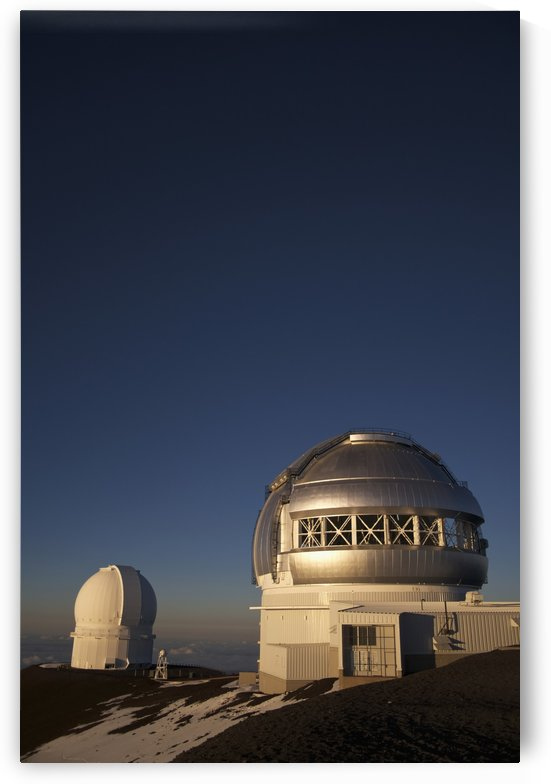 The sun sets over the summit of Mauna Kea and the domed observatories and telescopes; Island of Hawaii, Hawaii, United States of America by PacificStock