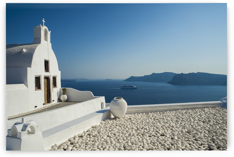 White church on the water's edge; Oia, Santorini, Greece by PacificStock
