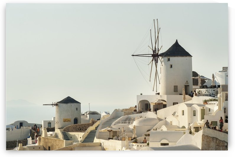 Whitewash buildings and windmill; Oia, Santorini, Greece by PacificStock