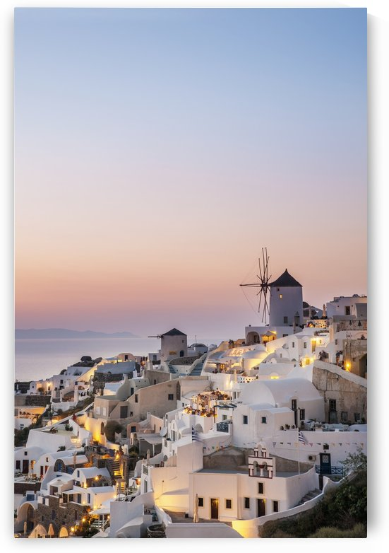 Whitewash buildings and windmill at dusk; Oia, Santorini, Greece by PacificStock