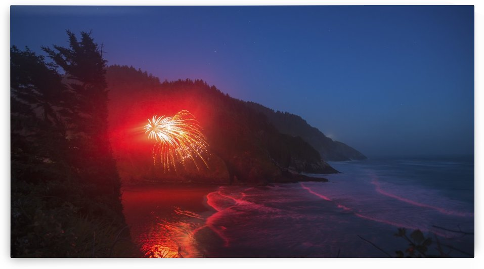 Fireworks erupting from the beach along the Oregon Coast; Oregon, United States of America by PacificStock