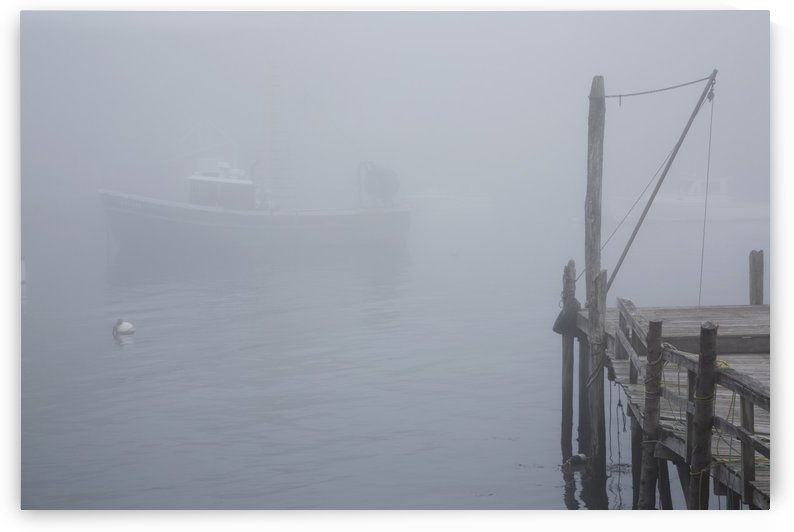 Lobster boat and boat dock in fog; New Harbor, Maine, United States of America by PacificStock