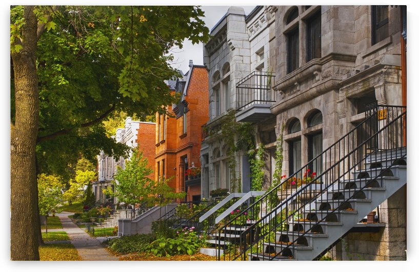 Apartment buildings along city street; Montreal, Quebec, Canada by PacificStock