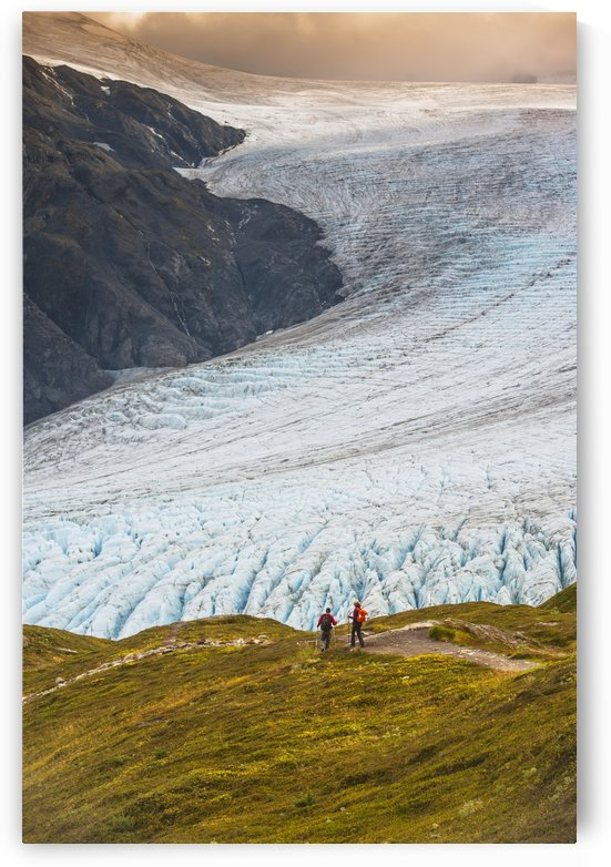 A man and woman hiking down the Harding Icefield Trail with Exit Glacier in the background, Kenai Fjords National Park, Kenai Penninsula, Southcentral Alaska by PacificStock