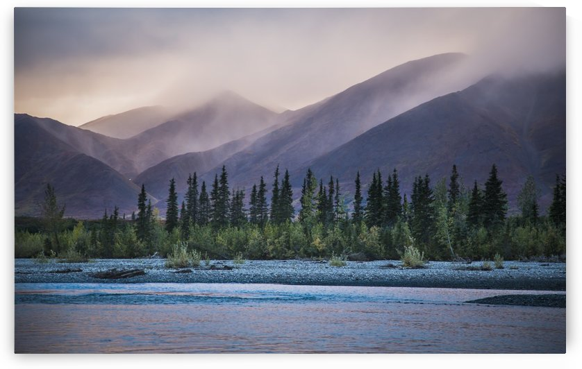 Rain and snow squalls race over the mountains during sunset on the Kelly River, in the western Brooks Range of Noatak National Preserve, Alaska, USA. by PacificStock
