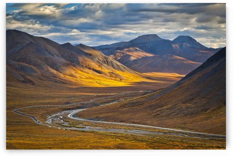 Sunset lighting Brooks Range at Chandalar Shelf, viewed from Atigun Pass between Gates of the Arctic National Park & preserve and Arctic National Wildlife Refuge with Dalton Hwy and pipeline cutting through the valley. Arctic Alaska, Autumn. by PacificStock