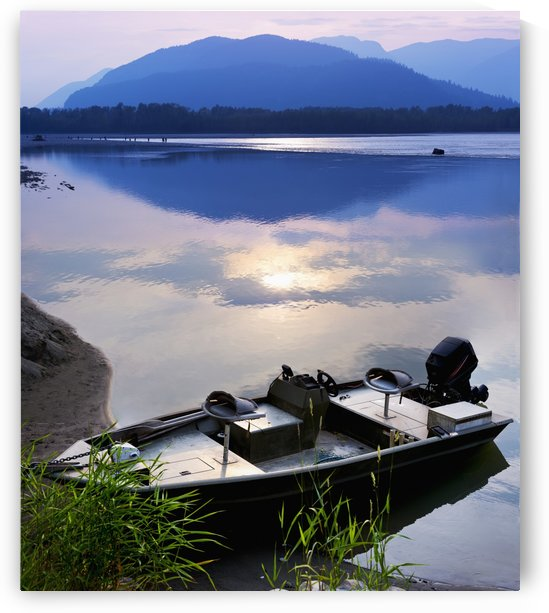 Boat moored on the Peg Leg Bar at sunset; Chilliwack, British Columbia, Canada by PacificStock