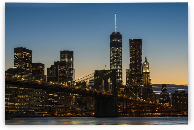 Lower Manhattan at twilight with the Brooklyn Bridge; New York City, New York, United States of America by PacificStock