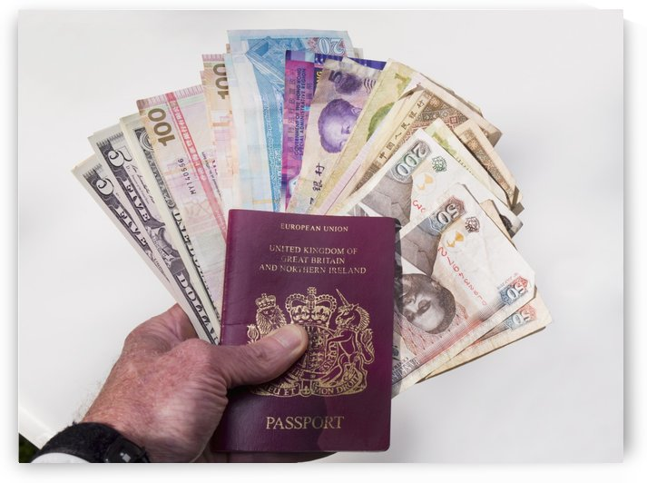 Money from various countries and a European Union passport by PacificStock