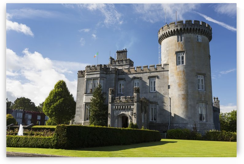 Stone castle with turret, manicured grass, gardens, fountain, blue sky and clouds; County Clare, Ireland by PacificStock