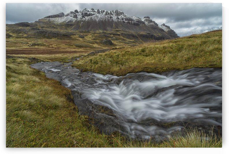 One of the numerous streams coming from the mountains in the West Fjords region of Iceland; Iceland by PacificStock