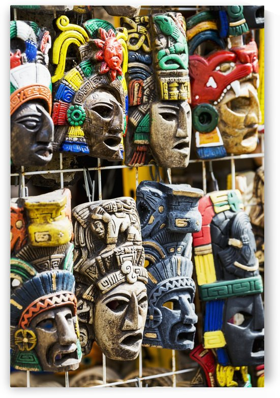 Close up of colourfully painted Mayan masks hanging on display; Akumal, Quintana Roo, Mexico by PacificStock