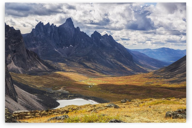 In the Yukon's North country, Tombstone mountain stands out above the tundra and surrrounding landscape; Yukon, Canada by PacificStock