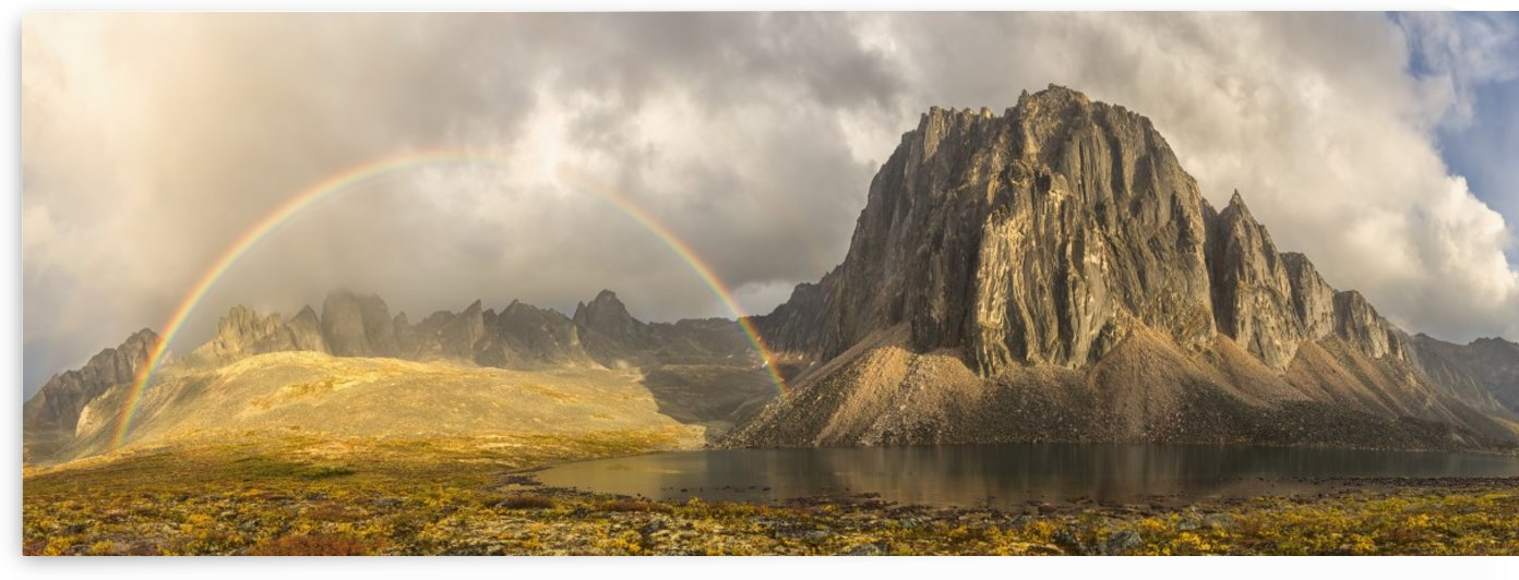 Rainbow over unnamed mountain by Talus Lake in Tombstone Territorial Park; Yukon, Canada by PacificStock