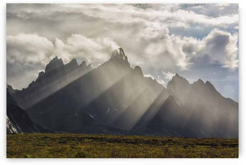 Sunlight streaks through rain and mist by Tombstone Mountain in Tombstone Territorial Park; Yukon, Canada by PacificStock