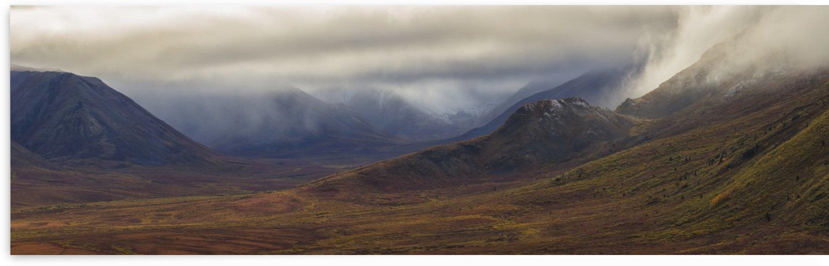 The Blackstone Valley along the Dempster Highway is shrouded in clouds in autumn; Yukon, Canada by PacificStock