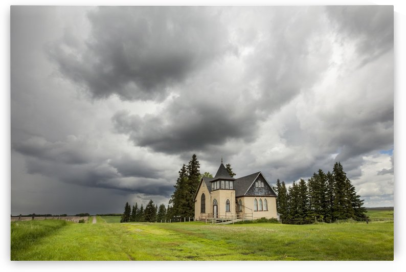 Church in a rural setting with storm clouds overhead; Winnipeg, Manitoba, Canada by PacificStock