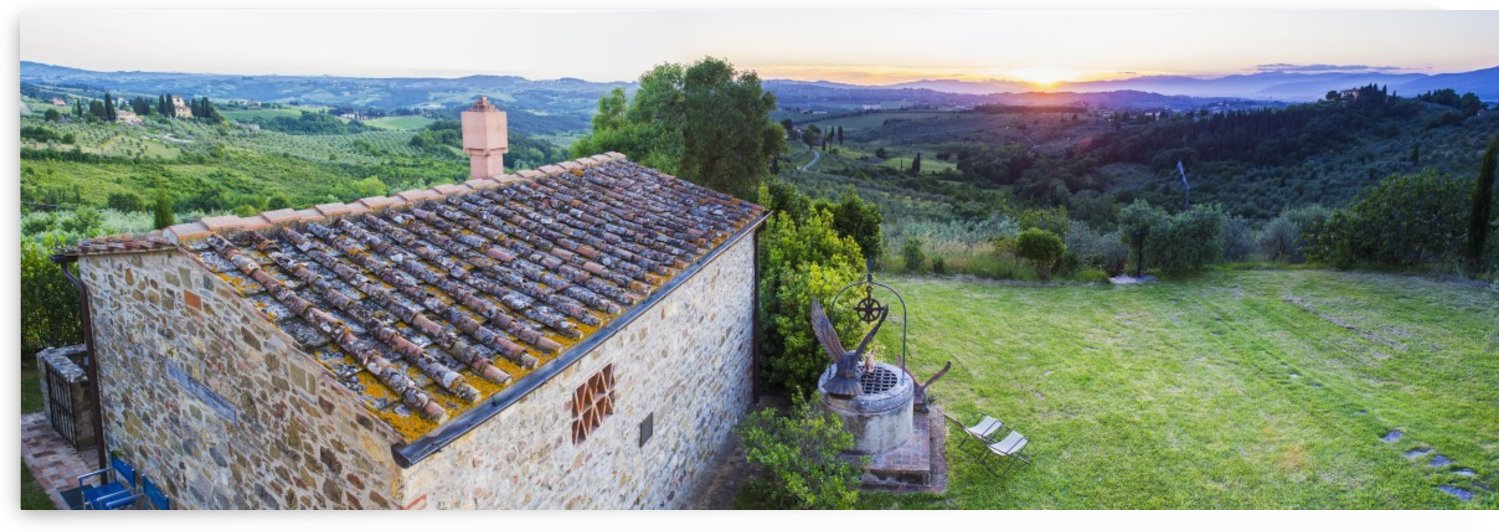 A stone house and a view of the lush landscape at sunset, Villa Capanuccia; Florence, Italy by PacificStock
