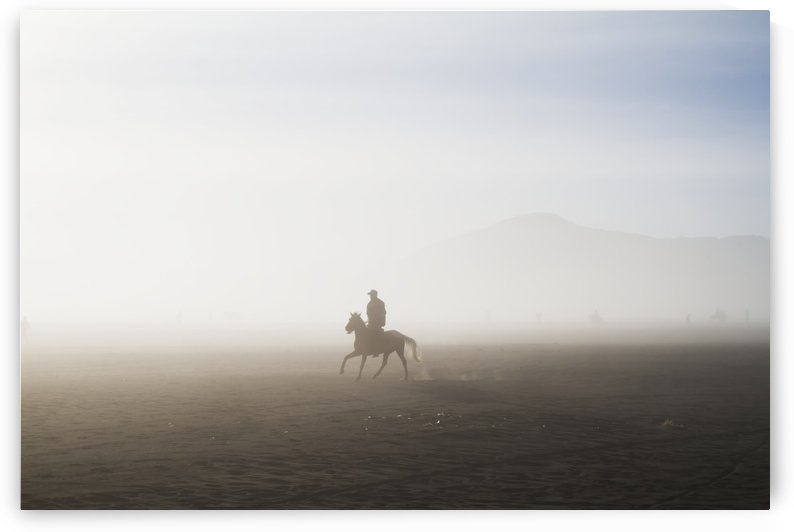 Man riding a horse in the Tengger Sand Sea, Bromo Tengger Semeru National Park, East Java, Indonesia by PacificStock