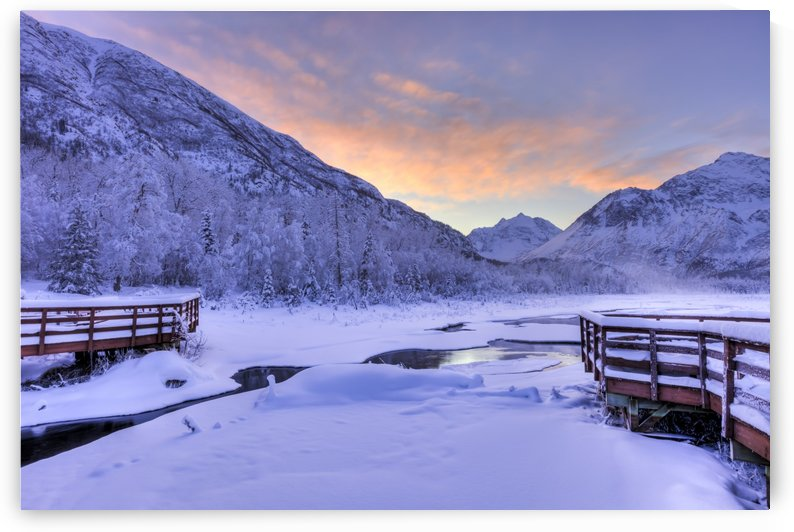 Colorful sunrise over a stream and the salmon viewing deck at the Eagle River Nature Center in Chugach State Park, Southcentral Alaska, Winter, HDR by PacificStock
